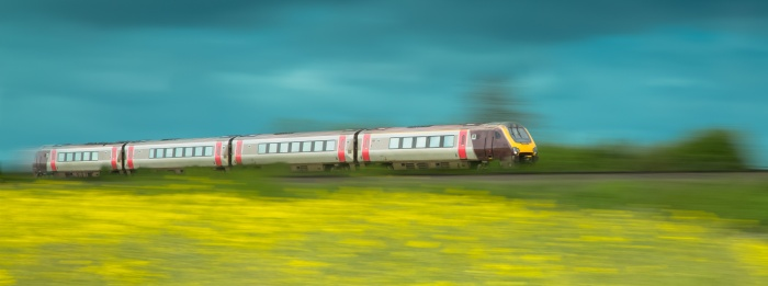 Train speeding by in the countryside